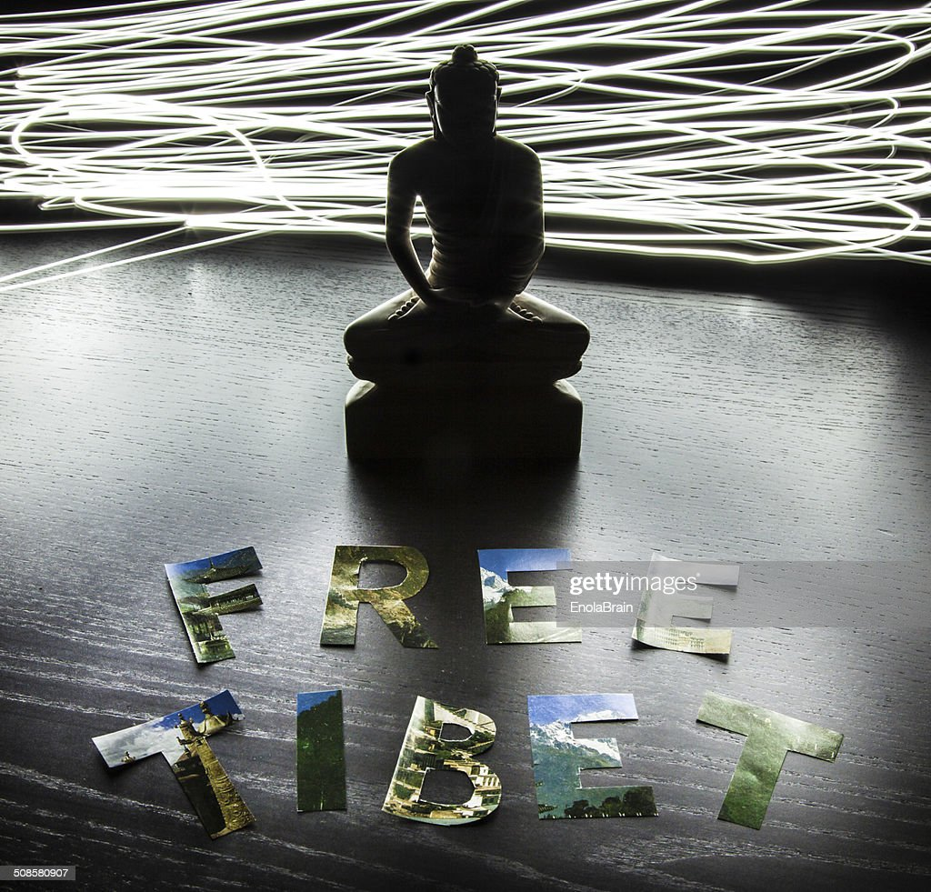 Buddha statue with Free Tibet letters : Stock Photo