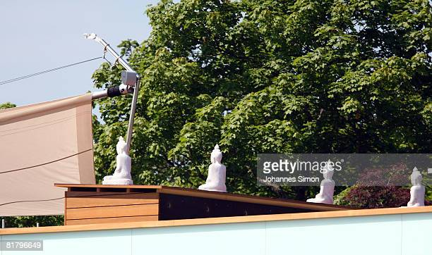 Buddha statues are seen at the roof of Bayern Munich home at Bayern's training ground Saebener Strasse on July 2 2008 in Munich Germany