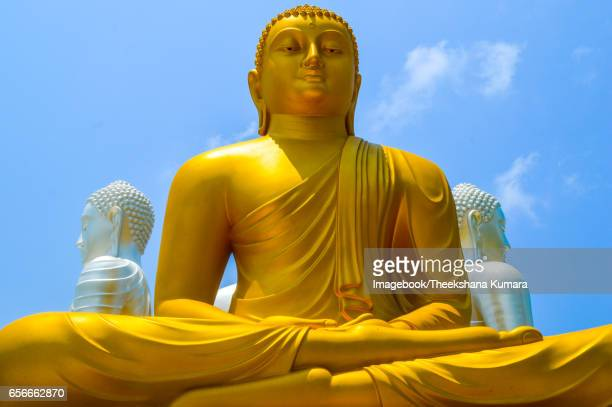 buddha statues at gangaramaya temple - sri lankan culture stock pictures, royalty-free photos & images