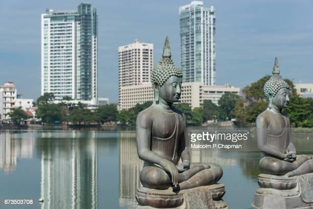 buddha statues at seema malaka temple with colombo skyline, sri lanka - colombo stock pictures, royalty-free photos & images