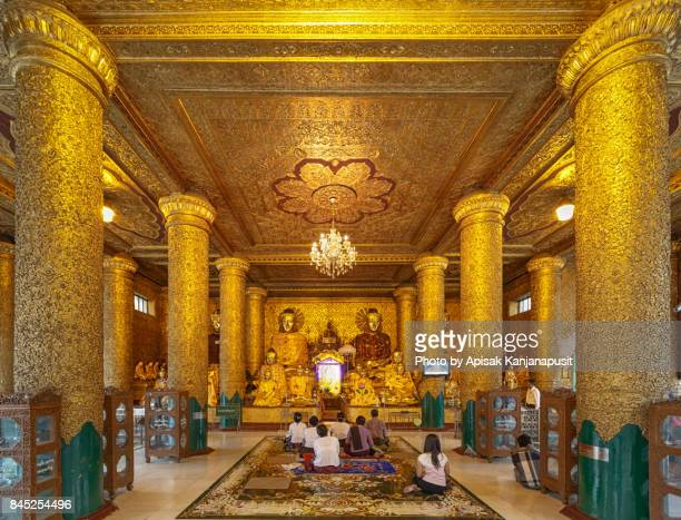 Buddha statues at Shwedagon Pagoda, Yangon, Myanmar