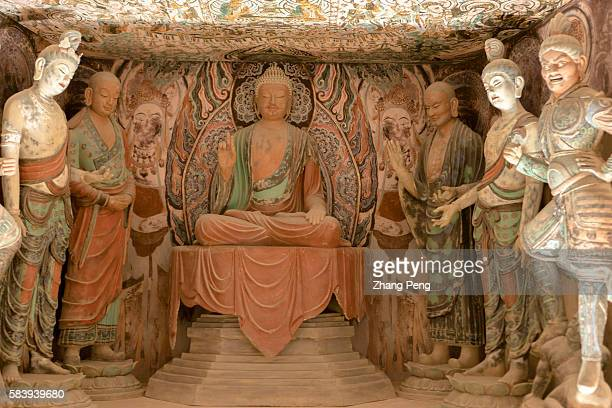 Buddha statues in the replica of cave 45 exhibited in Dunhuang Museum The Mogao Caves also known as the Thousand Buddha Grottoes are the best known...