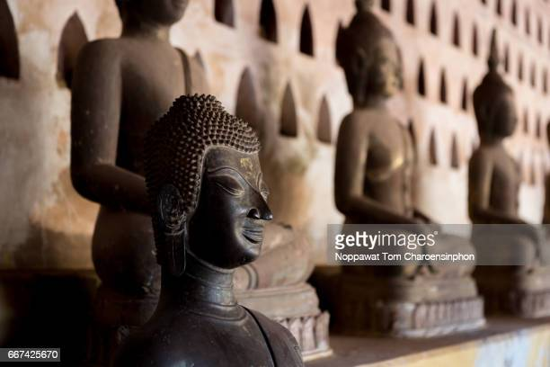buddha statues in wat sisaket, vientiane, laos - laotian culture stock pictures, royalty-free photos & images