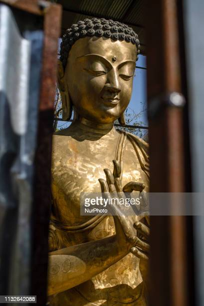 Buddha statues on the territory of the monastery complex under construction Monastic Zone Lumbini Nepal on March 22 2019 Lumbini is one of the worlds...