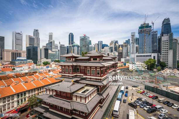 buddha tooth relic temple and singapore skyline - singapore city stock pictures, royalty-free photos & images