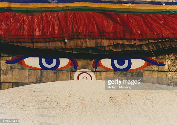 Buddhas eyes on the Boudhanath Stupa in Kathmandu Bordering Tibet and for desperate Tibetan refugees walking distance Nepal and more particularly...