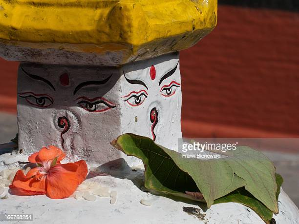 Buddhas eyes with beautiful little offerings, placed by the local devotees. .