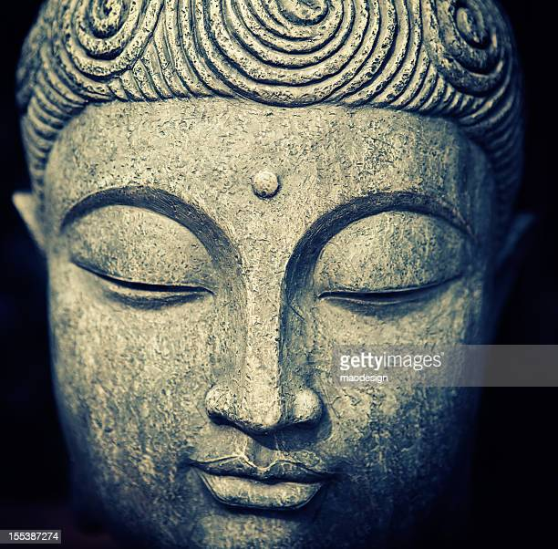 buddha's face - buddha stock photos and pictures
