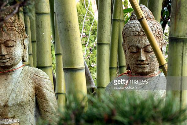 Buddhas silently contemplating bamboo forest