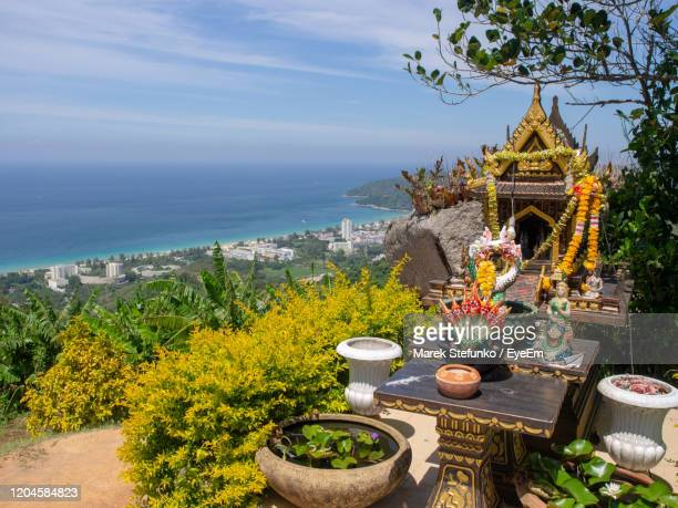 buddhist altar with view on karon beach - marek stefunko stock pictures, royalty-free photos & images