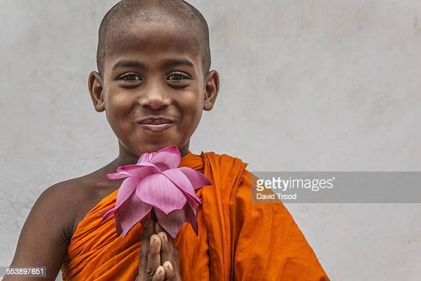 Buddhist boy with lotus flower