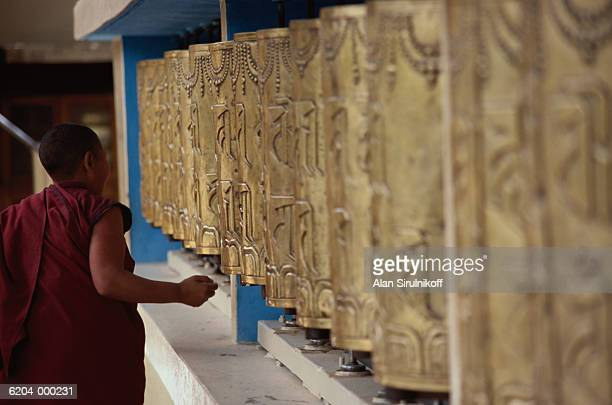 buddhist by prayer wheels - sirulnikoff stock pictures, royalty-free photos & images