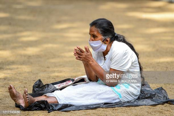 A Buddhist devotee prays at the Kelaniya temple during the Poson Poya religious festival marking the arrival of Buddhism in the island on the...