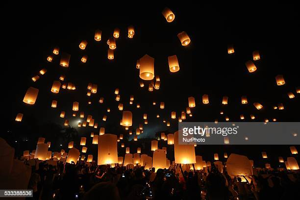 Buddhist devotees and visitors take part in lantern ceremony at Borobudur Temple ahead to Vesak celebration on May 21 2016 in Magelang Indonesia...