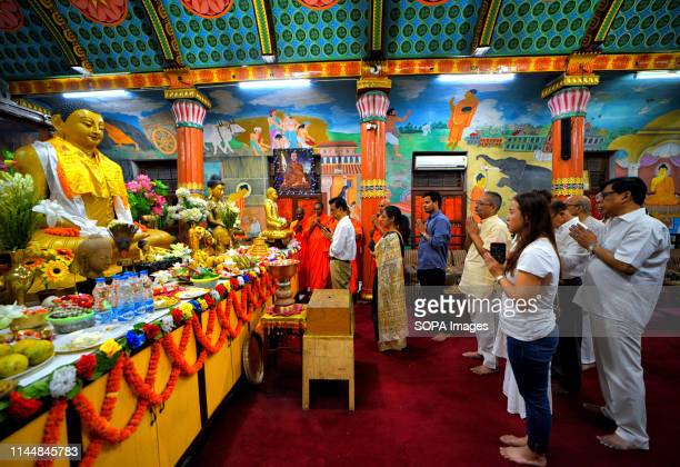 Buddhist Devotees are seen praying in front of a statue of Lord Buddha during the Buddha Purnima Prayers. Buddha's birthday is a holiday...