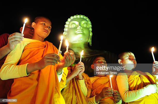 Buddhist devotees on the occasion of Buddha Purnima at a monastery on May 3 2015 in Bhopal India Buddha Purnima or Buddhas birthday is usually...