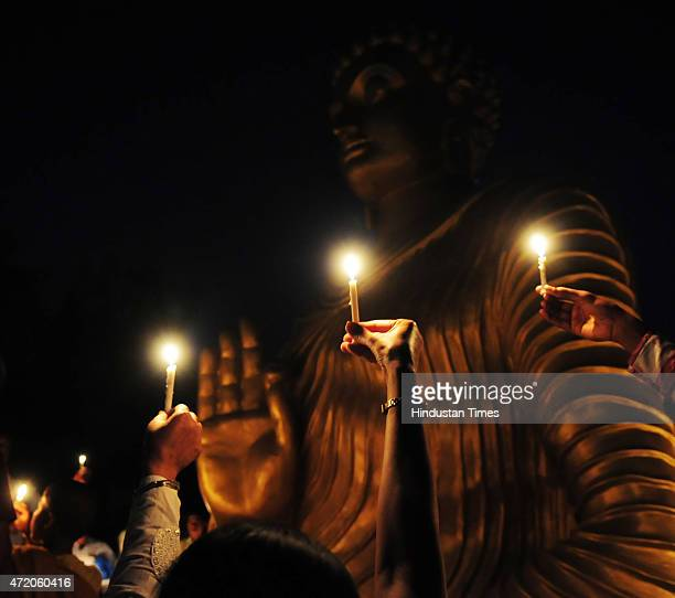 Buddhist devotees on the occasion of Buddha Purnima at a monastery, on May 3, 2015 in Bhopal, India. Buddha Purnima or Buddhas birthday is usually...