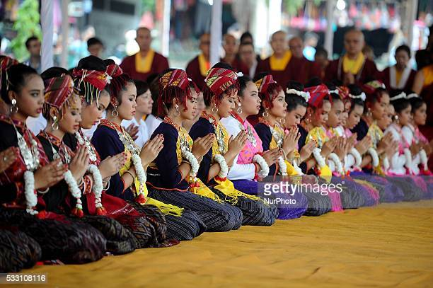 Buddhist devotees pray ahead to Vesak day at Mendut temple on May 20 2016 in Magelang Indonesia Millions of Buddhists around the world celebrate...