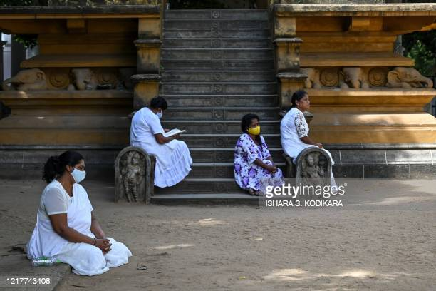 Buddhist devotees pray at the Kelaniya temple during the Poson Poya religious festival marking the arrival of Buddhism in the island on the outskirts...