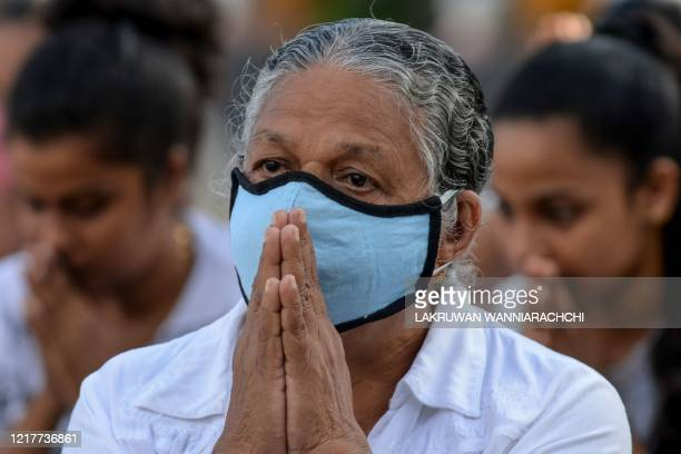 Buddhist devotees pray in Sri Vidyashanthi Temple in Colombo on June 5 during the Poson Poya religious festival Sri Lanka celebrates Poson a Buddhist...