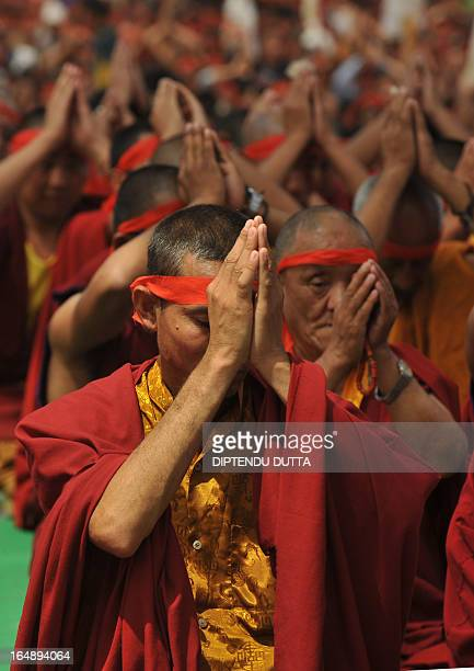 Buddhist devotees pray with the Tibetan spiritual leader the Dalai Lama during the final day of spiritual lessons at the Kalachakra Phodong Monastery...