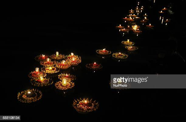 Buddhist devotees release lotus candles on the river ahead to Vesak day on May 20 2016 in Magelang Indonesia Millions of Buddhists around the world...