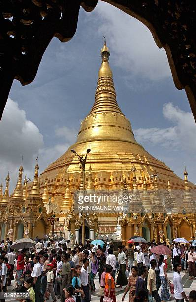 Buddhist devotees visit the grounds of Shwedagon Pagoda in downtown Yangon on July 17 2008 to mark the day when Buddha delivered his first sermon...