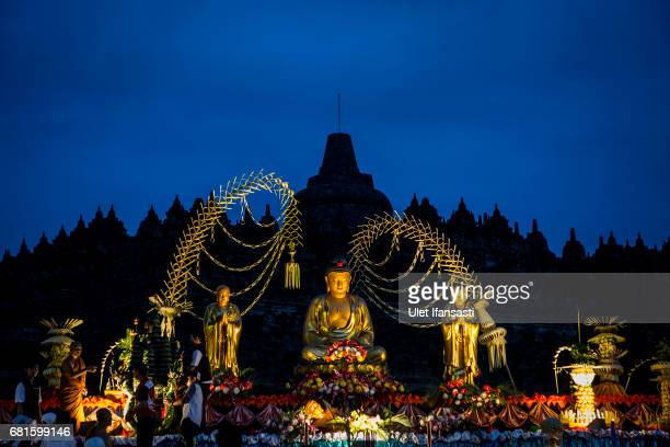 Buddhist followers at Borobudur temple during celebrations for Vesak Day on May 10 2017 in Magelang Central Java Indonesia Buddhists in Indonesia...