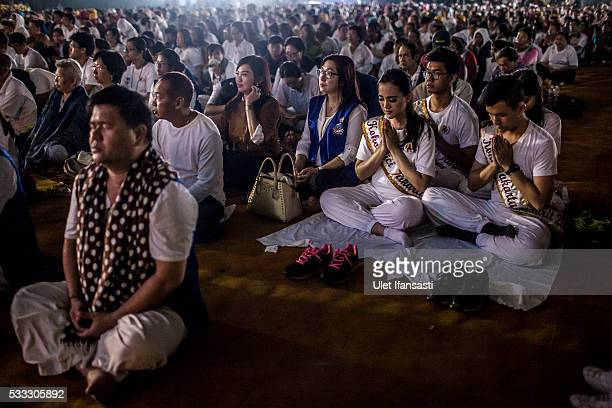 Buddhist followers pray at the Borobudur temple during celebrations for Vesak Day on May 22 2016 in Magelang Central Java Indonesia Vesak is observed...