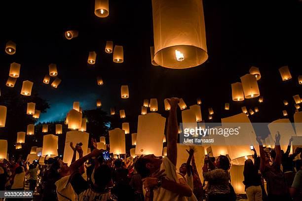 Buddhist followers release lanterns into the air on Borobudur temple during celebrations for Vesak Day on May 21 2016 in Magelang Central Java...
