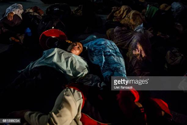 Buddhist followers sleep as they take a rest during celebrations for Vesak Day at Borobudur temple on May 10 2017 in Magelang Central Java Indonesia...