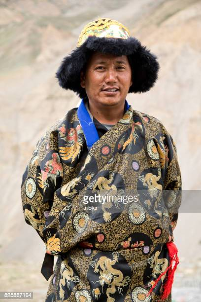 Buddhist man in traditional costume