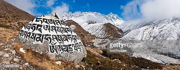 Buddhist mani stone carved mantra Khumbu valley panorama Himalayas Nepal