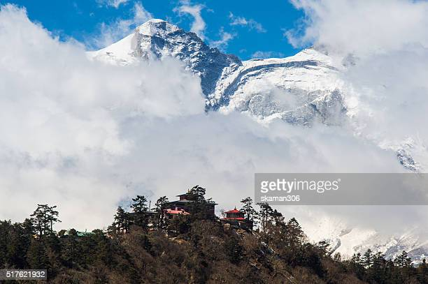 buddhist monastery building with himalayas snow mountain tengboche village, view from debuche village - solu khumbu stock pictures, royalty-free photos & images