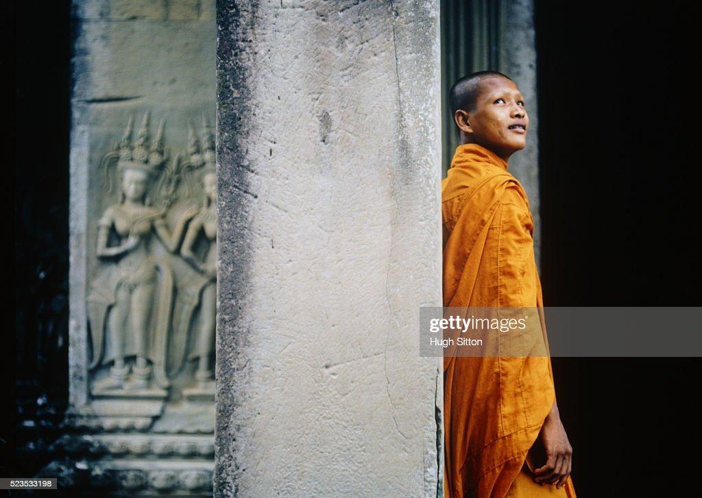 Buddhist Monk Against Column : Stock Photo