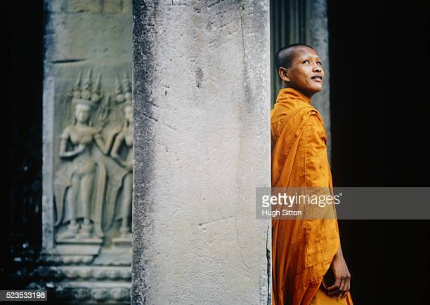 Buddhist Monk Against Column