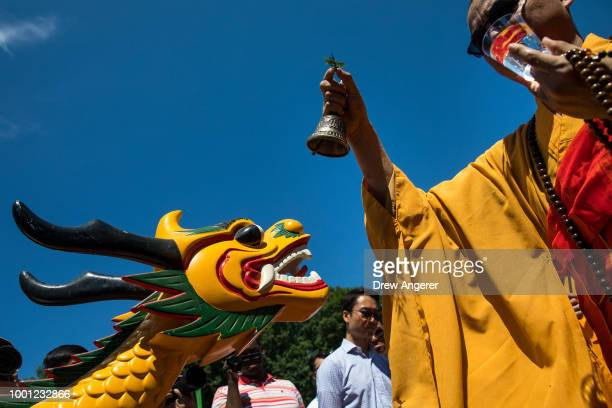 Buddhist monk blesses a dragon boat during a traditional dragon boat awakening ceremony in Central Park July 18 2018 in New York City The 28th annual...