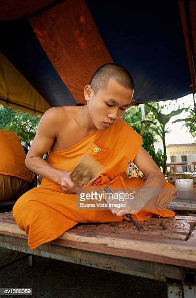 Buddhist Monk Carving wood in Vientiane, Mekong Valley, Laos