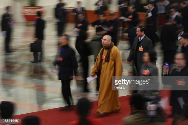 Buddhist monk delegate arrives at the Great Hall of the People to attend a plenary session of the National People's Congress on March 10 2013 in...