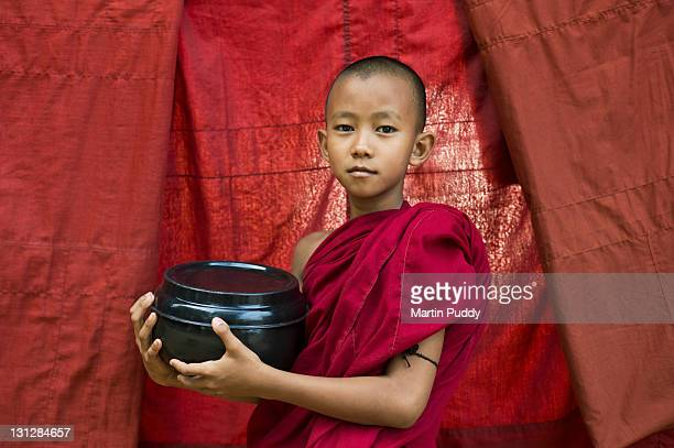 Buddhist Monk holding bowl for offerings