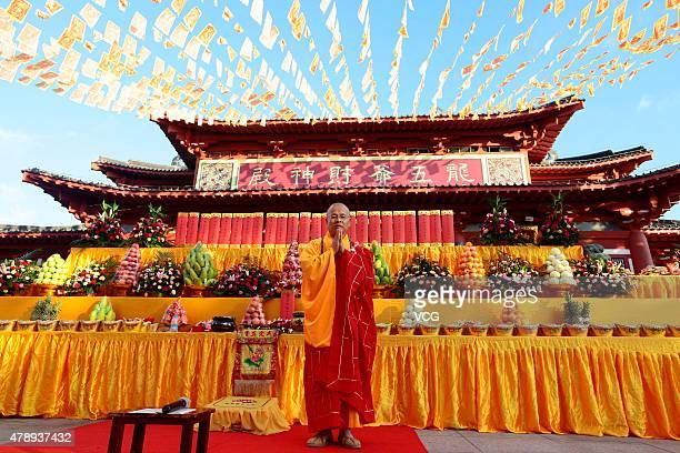 A Buddhist monk in chanting prayers during a celebration for the birthday of Longwuye at Nanshan Buddhist Culture Park on June 28 2015 in Sanya...