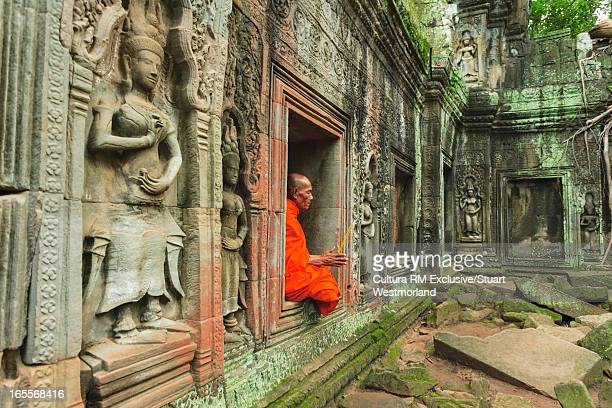 Buddhist monk in ornate temple