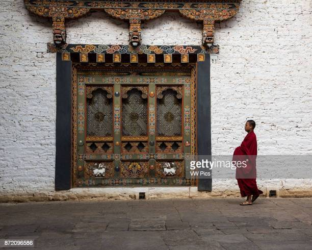 A Buddhist monk in the courtyard of the Punakha Dzong Punakha Bhutan