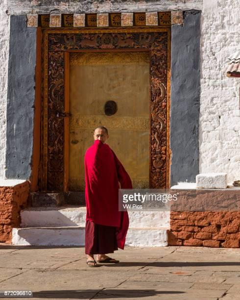 Buddhist monk in the religious courtyard of the Punakha Dzong, Punakha, Bhutan.