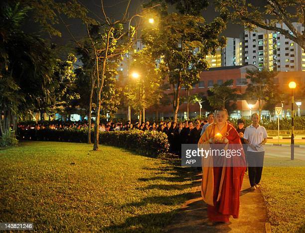 A Buddhist monk leads devotees during a procession towards a temple on the eve of Vesak Day in Singapore on May 42012 Vesak day is the major Buddhist...