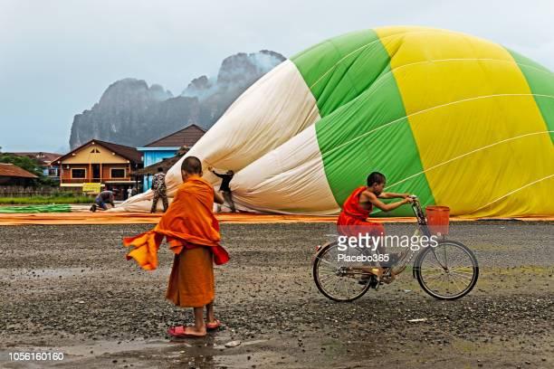 Buddhist monk looking at hot air balloon