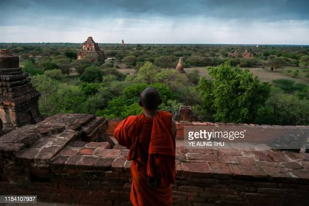 A Buddhist monk looks on as he visits the Sulamani ancient pagoda in Bagan on July 6 2019 The UNESCO World Heritage Committee on July 6 approved the...