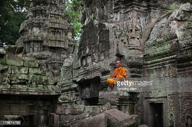 Buddhist monk meditates at Angkor Wat temple