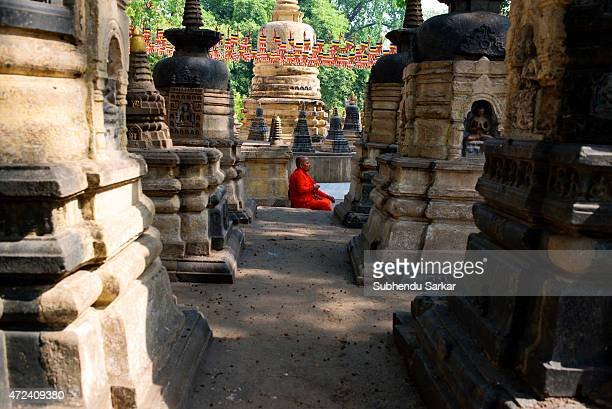 Buddhist monk meditates in the Mahabodhi temple complex as a part of Buddha Purnima celebrations in Bodh Gaya the place where lord Buddha attained...