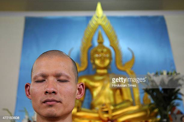 Buddhist monk offers prayers at a temple during Buddha Purnima festival on May 4 2015 in Noida India Vesak also known as Buddha Purnima marks the...